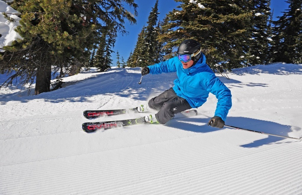 Skiing and Other Travel Deals on Globetrotting Mama for March 6. A man skis Big White Ski Resort.