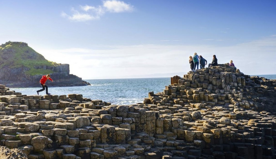 Travel Ireland- Tips for Family Friendly Fun on Globetrotting Mama. This photo features Giant's Causeway.