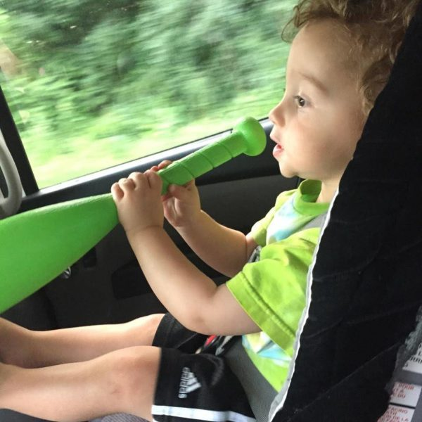 Alison Burke's son lip syncs on the road - Globetrotting Mama's Road Trip Tales Series.