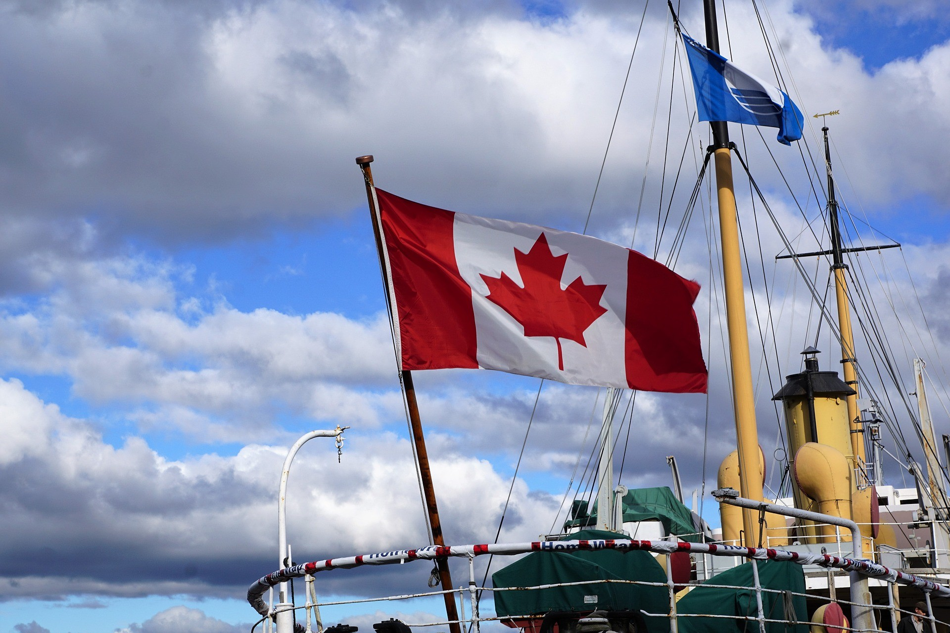 Save on travel this fall. Canadian flag flies in Halifax.