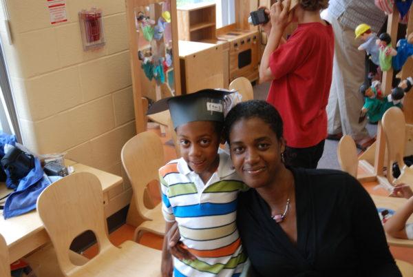 Motherhood: mom and son at kindergarten graduation