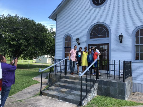 Family poses with the pastors of the historic church in New Orleans Plantation Country