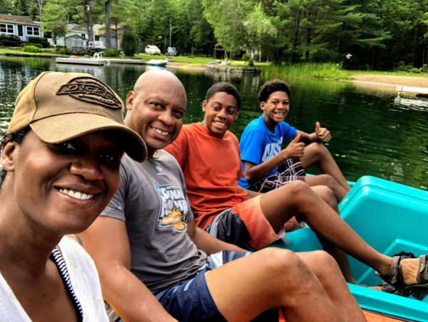 Black family enjoying cottage life; ontario travel