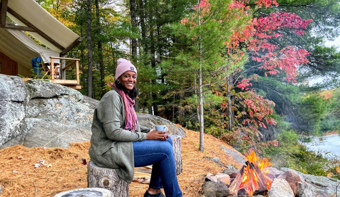 Fall colours canada woman sitting by fire